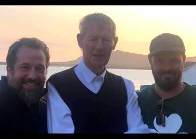 With Mícheál Ó Muircheartaigh